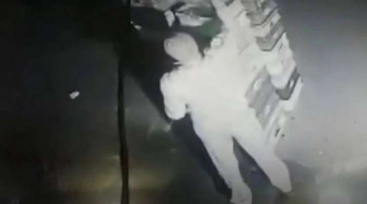 CCTV footage shows cop stealing milk packets from Noida