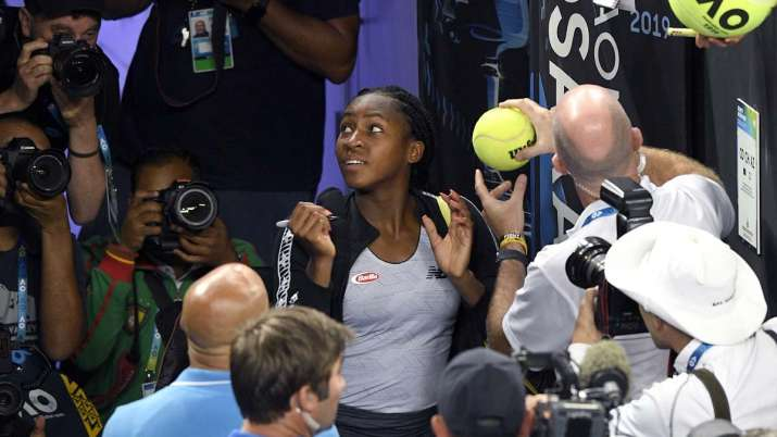 """United States' Cori """"Coco"""" Gauff signs autographs after"""
