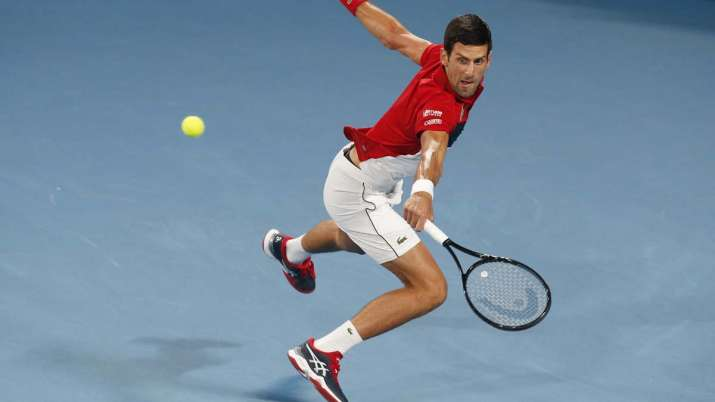 Novak Djokovic of Serbia plays a shot against Rafael Nadal