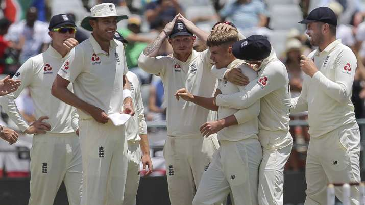 England celebrate the wicket of Pieter Malan during day