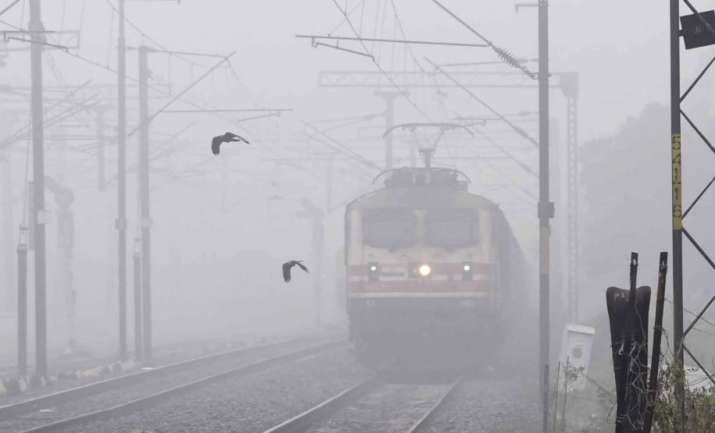 Patna: A train runs on its tracks amid a dense layer of fog during a cold winter morning