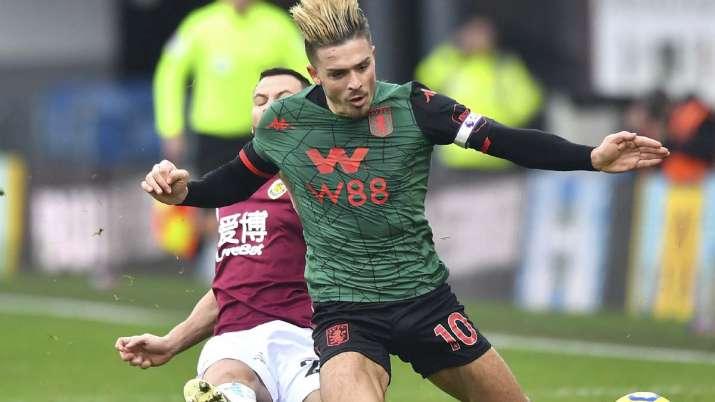 Burnley's Phil Bardsley, background tackles Aston Villa's