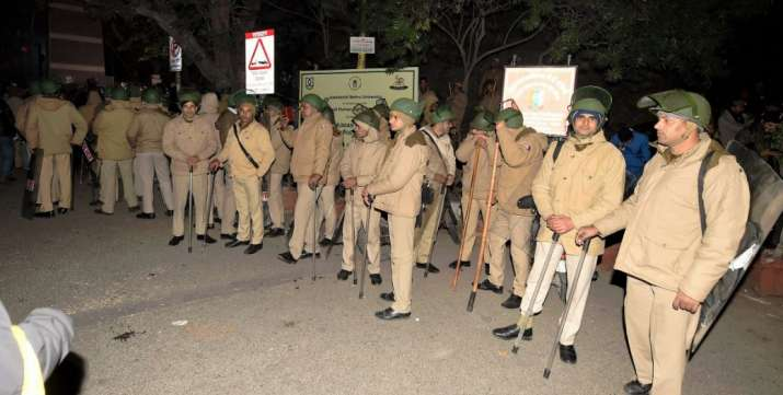 New Delhi: Policemen at out side of the JNU after some masked miscreants attacked in the campus