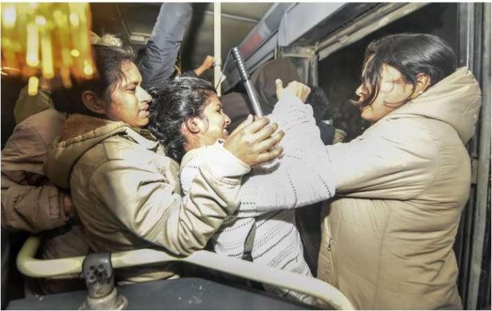 Delhi police detain Jawaharlal Nehru University (JNU) students who were protesting outside the Shast