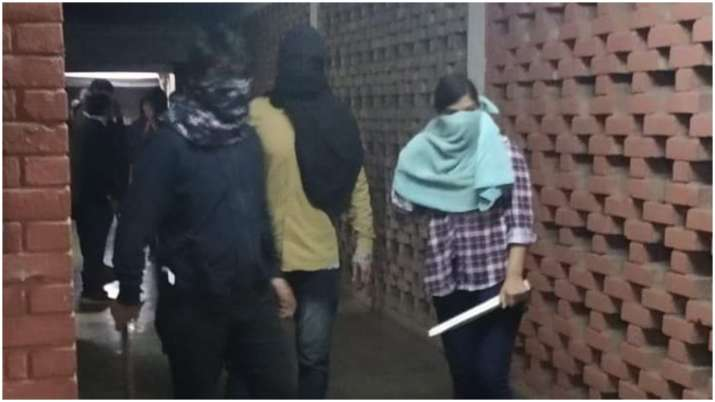 The masked people carrying sticks, accused of assaulting