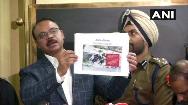 Delhi Police's DCP (Crime) Joy Tirkey holds up what he