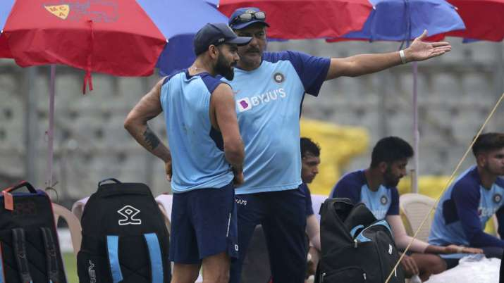India's cricket coach Ravi Shastri, right, chats with Virat