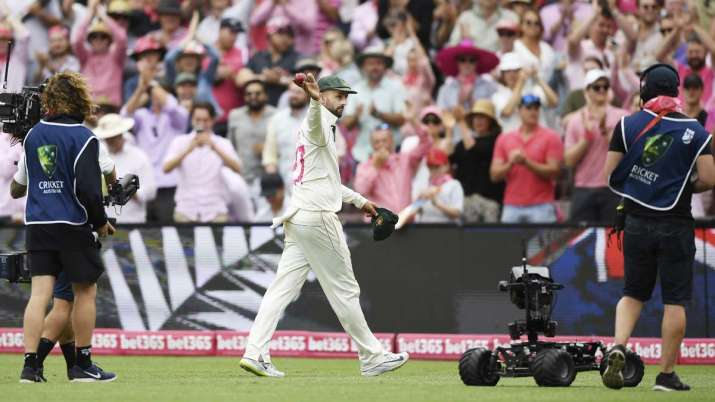 Australia's Nathan Lyon leaves the field after taking 5