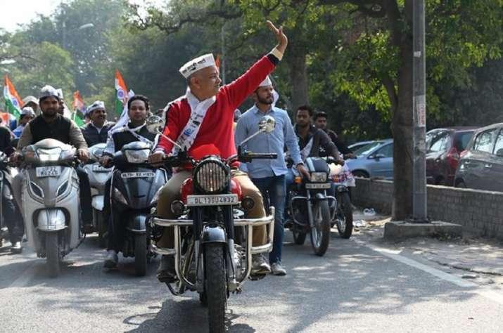 Delhi deputy chief minister Manish Sisodia riding a bike