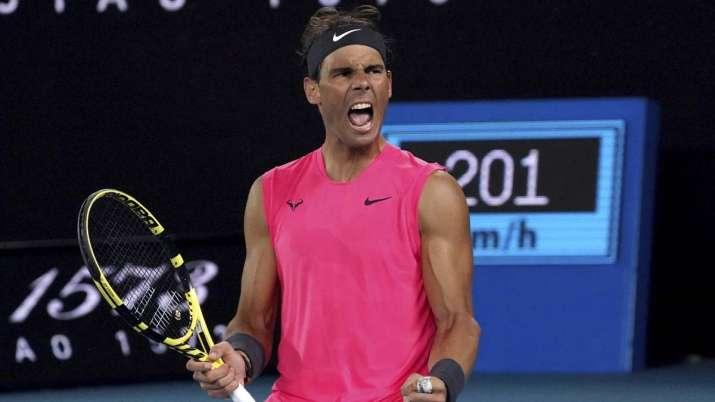 Spain's Rafael Nadal celebrates after winning the third set