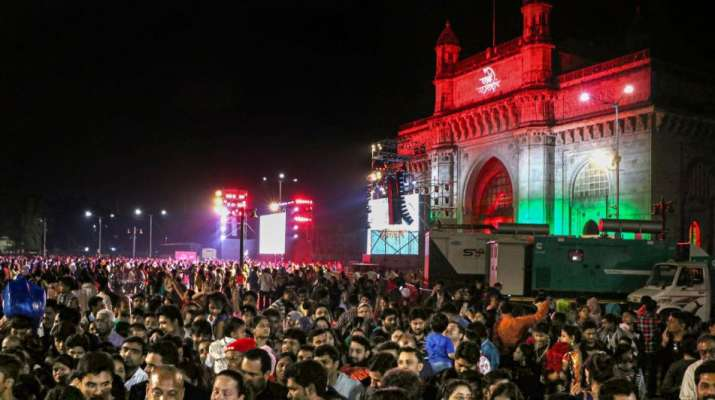 India Tv - Mumbai: People assemble at the historic Gateway of India on the eve of New Year, in Mumbai, Tuesday,