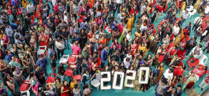 India Tv - Ahmedabad: Christian people meet and greet each other as they celebrate New Year at a Church in Ahme