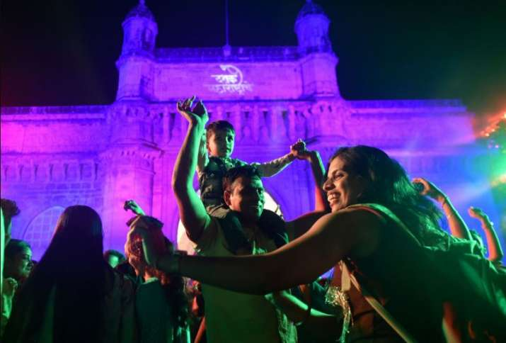 India Tv - Mumbai: People enjoy the New Years eve at Gateway of India in Mumbai, Tuesday, Dec. 31, 2019.