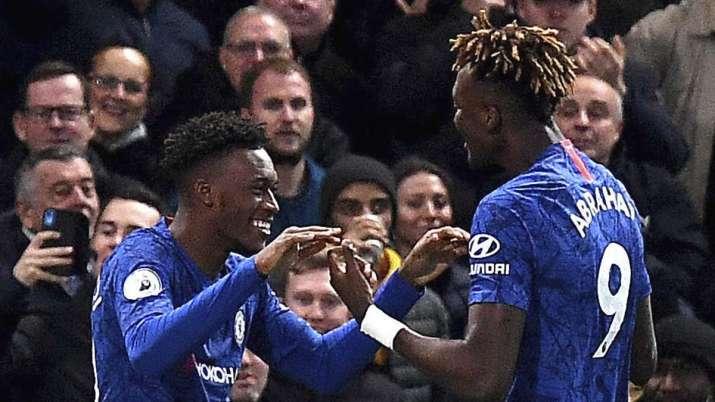 Chelsea's Callum Hudson-Odoi, left, celebrates scoring his