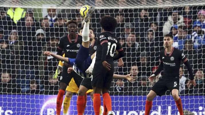 Brighton's Alireza Jahanbakhsh, centre, scores his side's