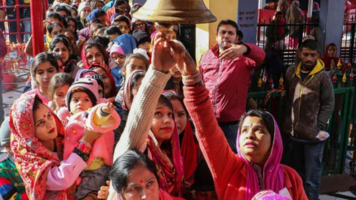 India Tv - Jammu: Devotees queue to offer prayers on the first day of the New Year 2020 at Kali Mata Temple in