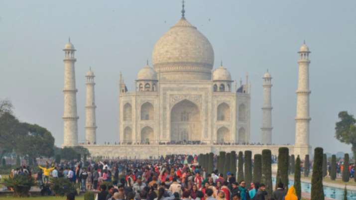 India Tv - Agra: Visitors throng to the historic Taj Mahal on the first day of New Year 2020, in Agra, Wednesda