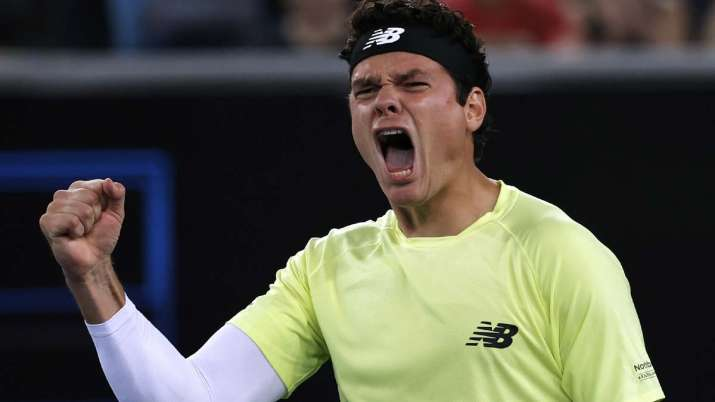 Canada's Milos Raonic celebrates after defeating Greece's