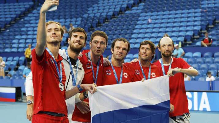 Daniil Medvedev, left, takes a selfie with his Russian team
