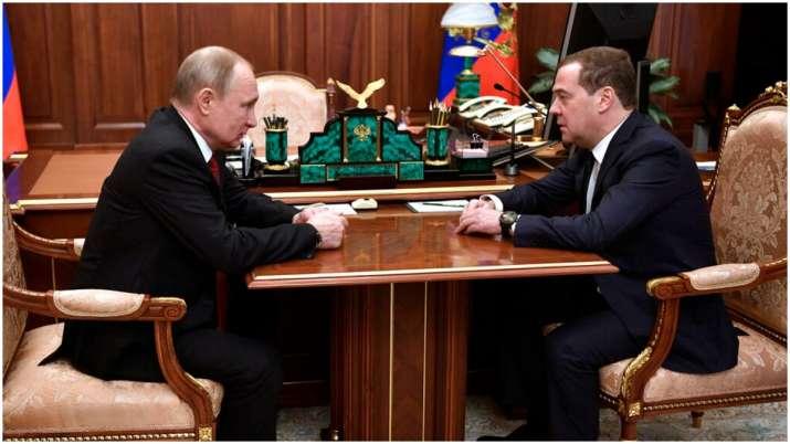 Russian President Vladimir Putin, left, listens to Russian