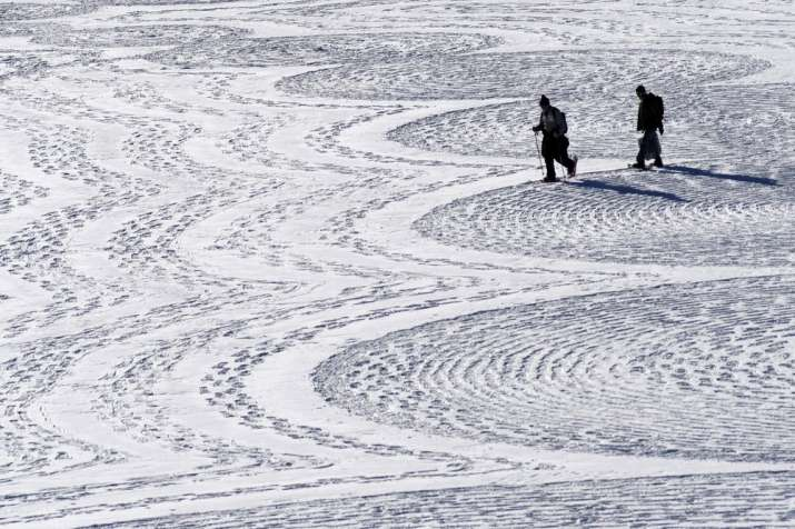 India Tv - Artist uses snow as canvas for massive geometrical designs