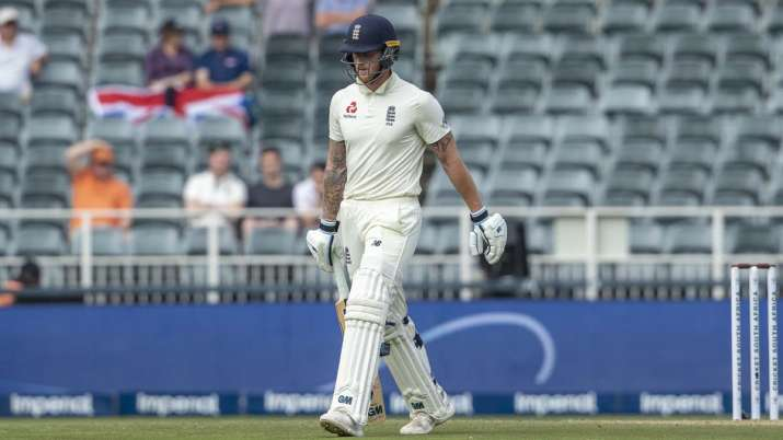 England's batsman Ben Stokes leaves the field after being