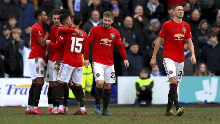 Manchester United's Anthony Martial, left, celebrates