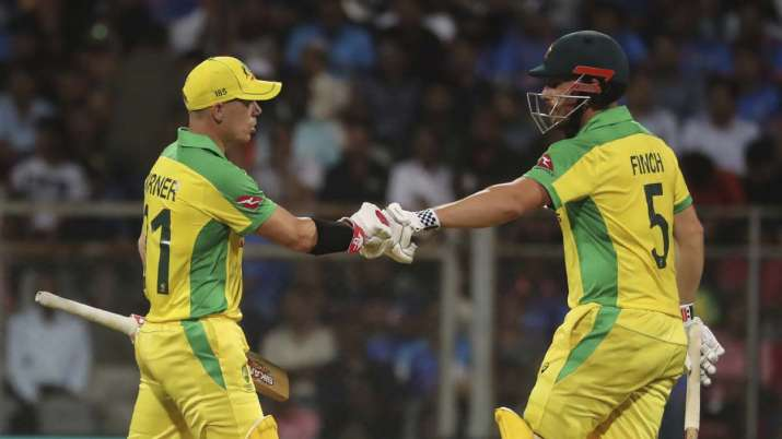 Australia's captain Aaron Finch, right, and David Warner