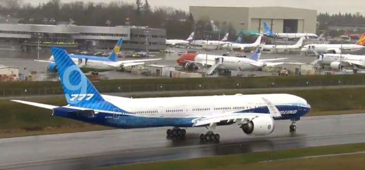 India Tv - Boeing 777X with world's largest jet engine embarks on maiden flight