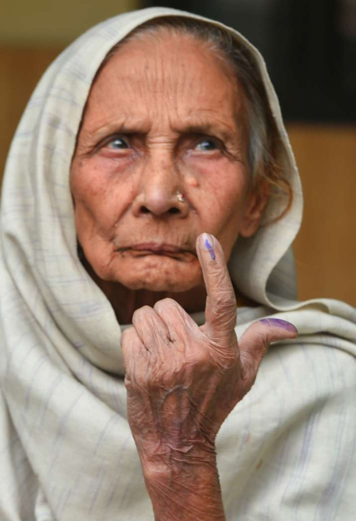 India Tv - 100 years old Zubedia Khatoon, shows her finger marked with indelible ink after casting vote during the Delhi Assembly elections, at a polling station in Old Delhi