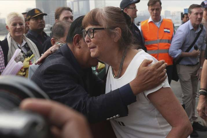 India Tv - A passenger, right, is hugged by Cambodia Prime Minister Hun Sen after she disembarked from the MS W