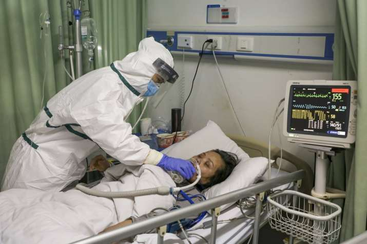 In this Thursday, Feb. 6, 2020, photo, a nurse feeds water to a patient in the isolation ward for 20