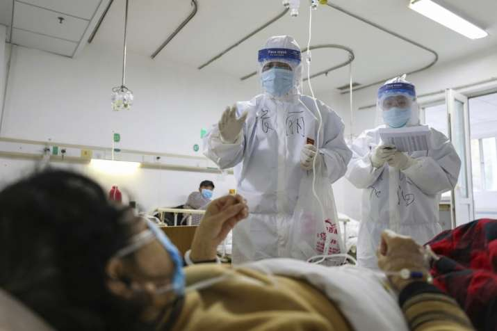 Surge in coronavirus cases takes death toll up to 1,367; China revises method to tally infected