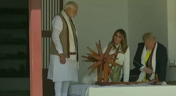 India Tv - US President Donald Trump and First Lady Melania Trump spin the Charkha at Sabarmati Ashram. PM Modi