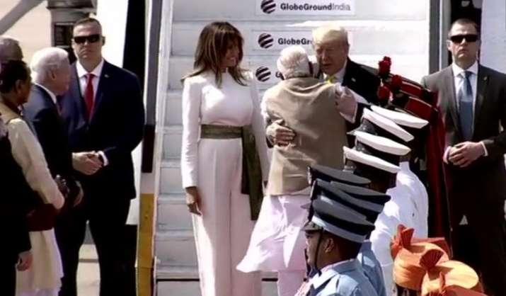 India Tv - Prime Minister Narendra Modi hugs US President Donald Trump upon his arrival in Ahmedabad.