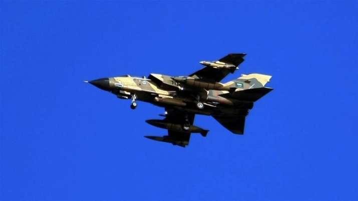 A Saudi Tornado warplane flies over the Gulf during a training mission