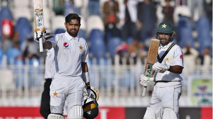 Pakistan batsman Babar Azam, right, celebrates after