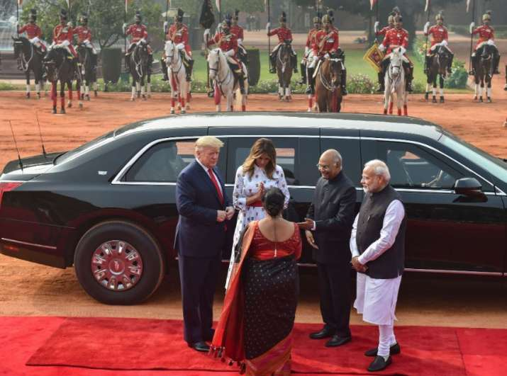 India Tv - New Delhi: US President Donald Trump and US First Lady Melania Trump exchange greetings with Preside