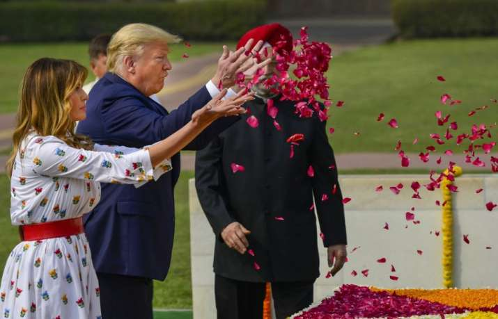 India Tv - New Delhi: US President Donald Trump and First Lady Melania Trump pay floral tribute to Mahatma Gand