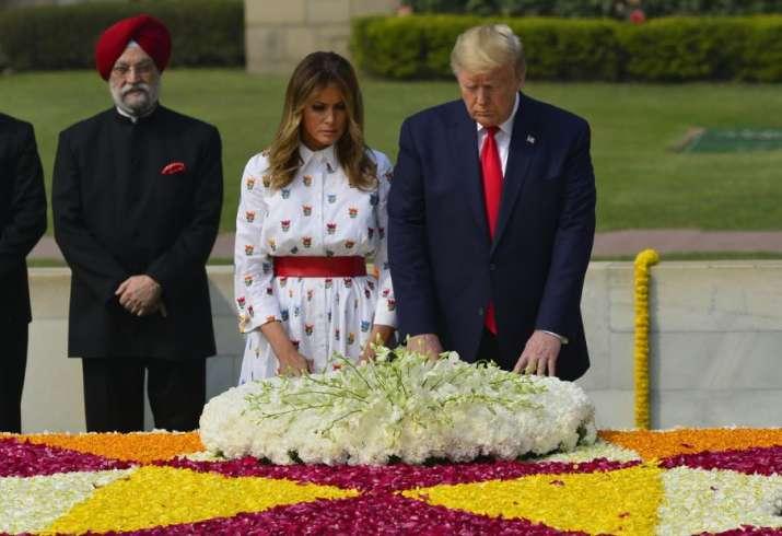 India Tv - New Delhi: US President Donald Trump and First Lady Melania Trump lay wreath at Rajghat, the memoria