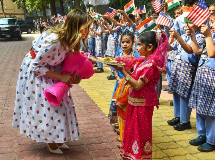 India Tv - New Delhi: US First Lady Melania Trump being welcomed during her visit to a government school to wit