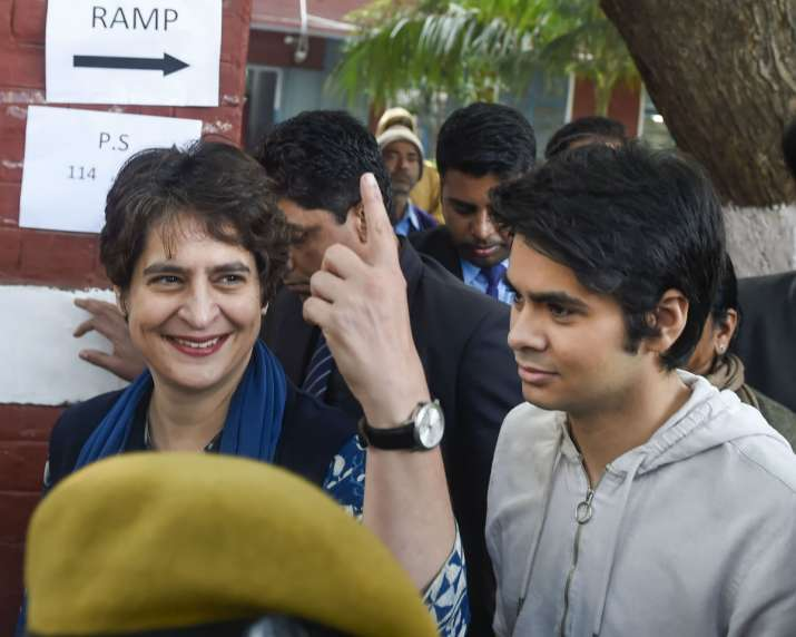 India Tv - Congress general secretary Priyanka Gandhi (L) along with her son Raihan Vadra, who voted for the first time, after casting vote during the Delhi Assembly elections at a polling station in Lodhi Estate area