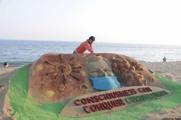 Sand artist Manas Sahoo makes a sand sculpture to create