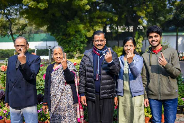 India Tv - Delhi Chief Minister and AAP convenor Arvind Kejriwal and his family members show their finger marked with indelible ink after casting vote during the Delhi Assembly elections at a polling station, in Civil Line area