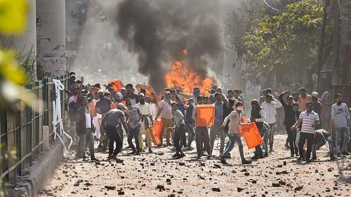 Northeast Delhi violence: Flag march in Maujpur area after clashes between pro and anti CAA protesto