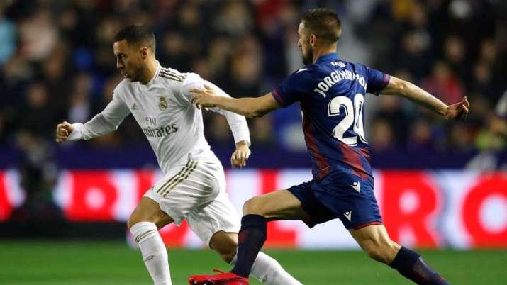 Real Madrid's Eden Hazard, left, and Levante's Jorge