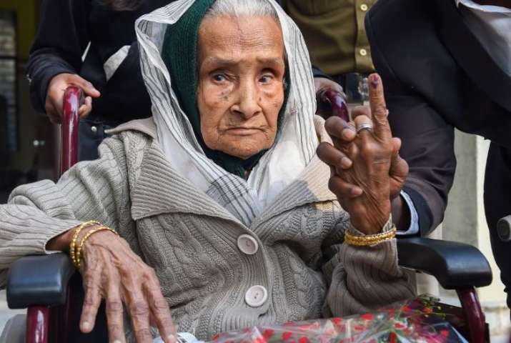 111-year-old Kalitara Mandal shows her finger marked with indelible ink after casting vote during th