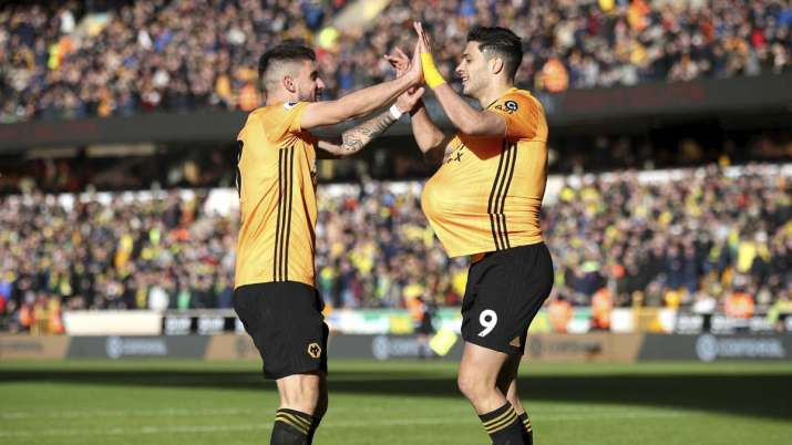 Wolverhampton Wanderers' Raul Jimenez, right, celebrates