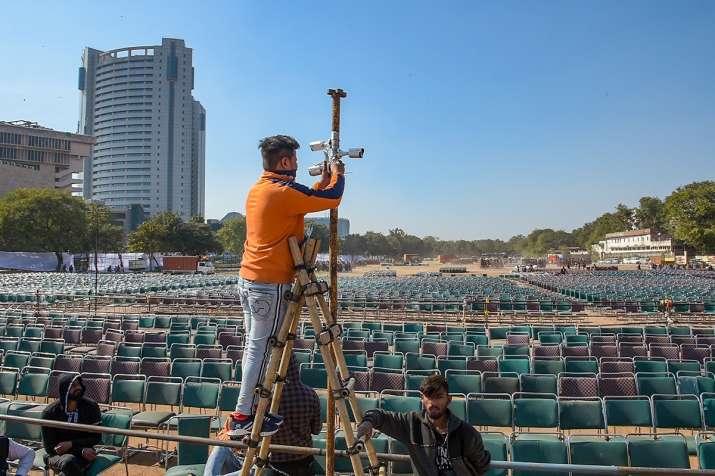 A worker installs CCTV cameras at Ramlila Maidan ahead of