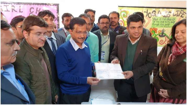 India Tv - Arvind Kejriwal receives a certificate of victory from Election Commission officer